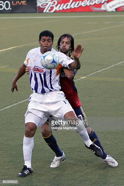 Gabriel Badilla of Deportivo Saprissa goes after the ball against Matias Mantilla of Real Salt Lake at Rice Eccles Stadium on July 23 2008 in Salt...