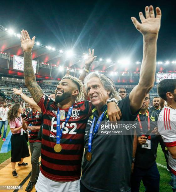 Gabriel Barbosa and head coach Jorge Jesus of Flamengo waving the fans after winning the Brasileirao 2019 after the match against Ceará at Maracana...