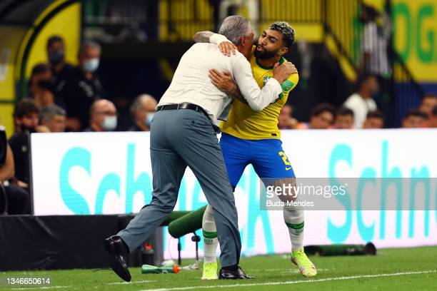 Gabriel Barbosa of Brazil celebrates with head coach Tite after scoring the fourth goal of his team during a match between Brazil and Uruguay as part...
