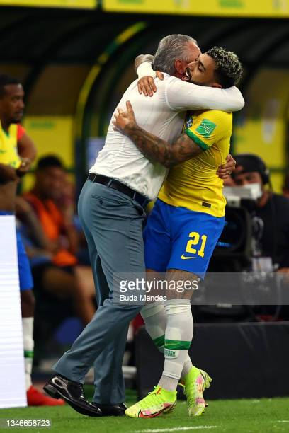 Gabriel Barbosa of Brazil celebrates with his head coach Tite after scoring the fourth goal of his team during a match between Brazil and Uruguay as...