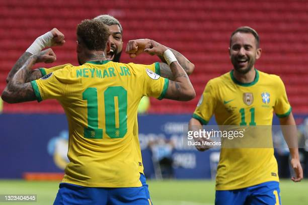Gabriel Barbosa of Brazil celebrates with teammate Neymar Jr. After scoring the third goal of his team during a Group B match between Brazil and...