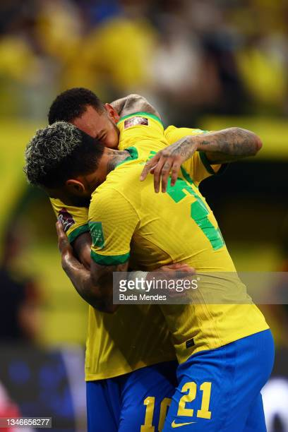 Gabriel Barbosa of Brazil celebrates with teammate Neymar Jr. After scoring the fourth goal of his teamduring a match between Brazil and Uruguay as...