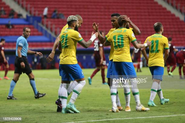 Gabriel Barbosa of Brazil celebrates with teammates after scoring the third goal of his team during a Group B match between Brazil and Venezuela as...