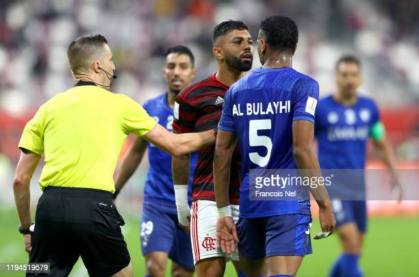 Gabriel Barbosa of CR Flamengo confronts Ali Albulayhi of Al Hilal SFC during the FIFA Club World Cup semifinal match between CR Flamengo and Al...