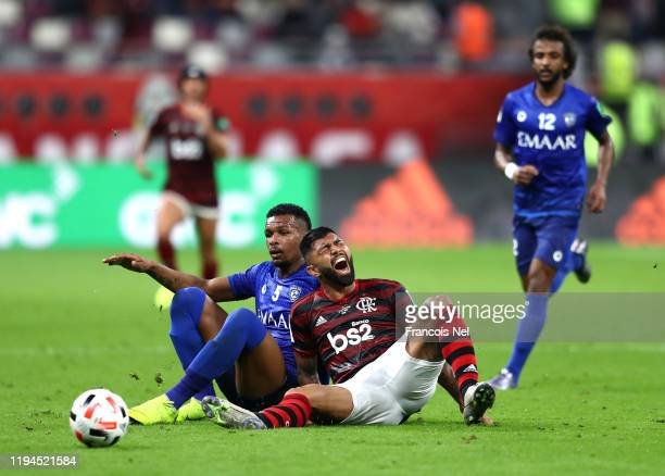 Gabriel Barbosa of CR Flamengo is challenged by Ali Albulayhi of Al Hilal SFC during the FIFA Club World Cup semi-final match between CR Flamengo and...