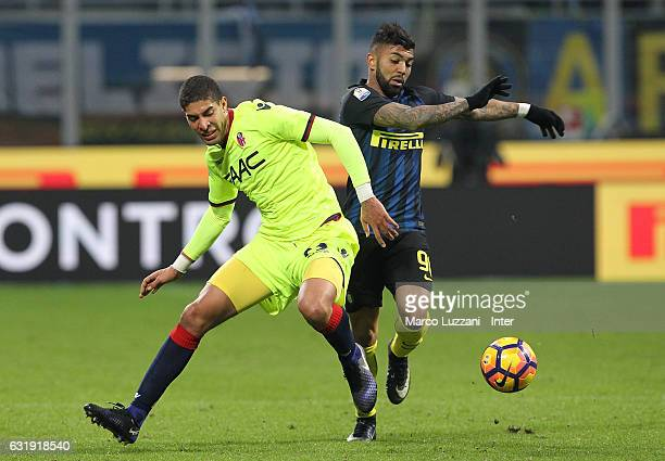 Gabriel Barbosa of FC Internazionale competes for the ball with Adam Masinar of Bologna FC during the TIM Cup match between FC Internazionale and...