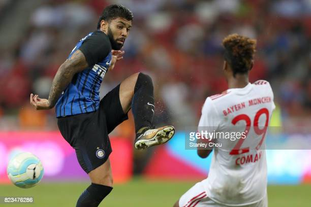 Gabriel Barbosa of FC Internazionale holds off Kingsley Coman of FC Bayern during the International Champions Cup match between FC Bayern and FC...