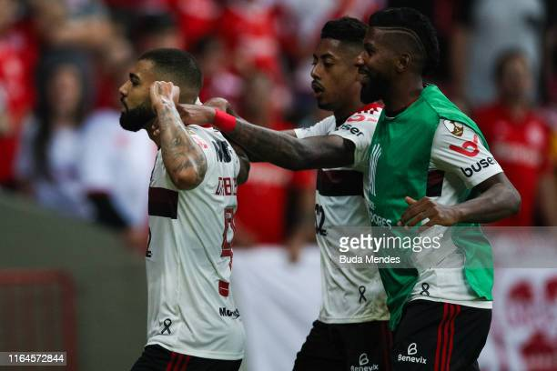 Gabriel Barbosa of Flamengo celebrates with teammates after scoring the first goal of his team during a match between Internacional and Flamengo as...