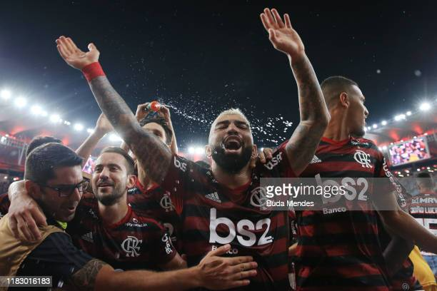 Gabriel Barbosa of Flamengo celebrates with teammates after winning a second leg semifinal match between Flamengo and Gremio as part of Copa CONMEBOL...