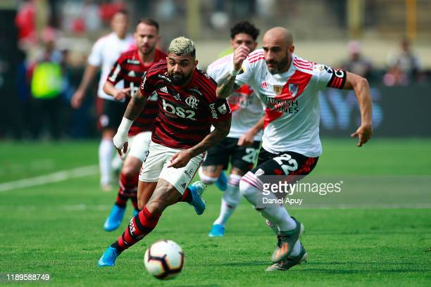 Gabriel Barbosa of Flamengo fights for the ball with Javier Pinola of River Plate during the final match of Copa CONMEBOL Libertadores 2019 between...