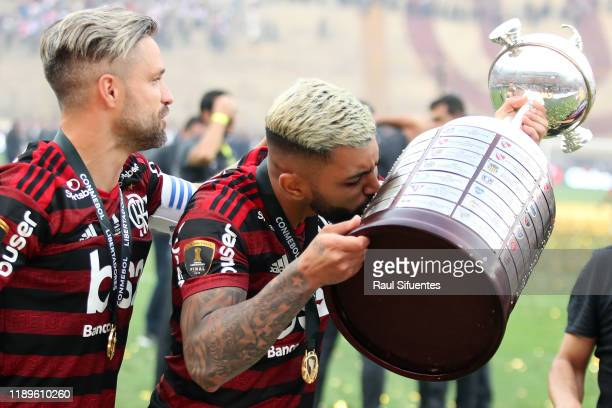 Gabriel Barbosa of Flamengo kissis the trophy after winning during the final match of Copa CONMEBOL Libertadores 2019 between Flamengo and River...