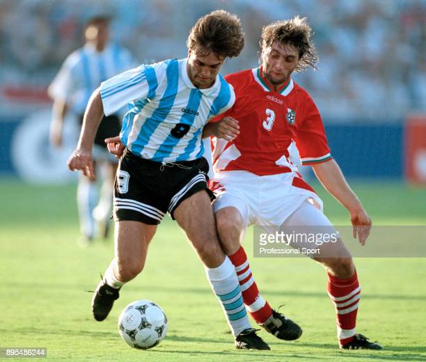 Gabriel Batistuta of Argentina and Trifon Ivanov of Bulgaria in action during a 1994 FIFA World Cup group game at the Cotton Bowl on June 30 1994 in...