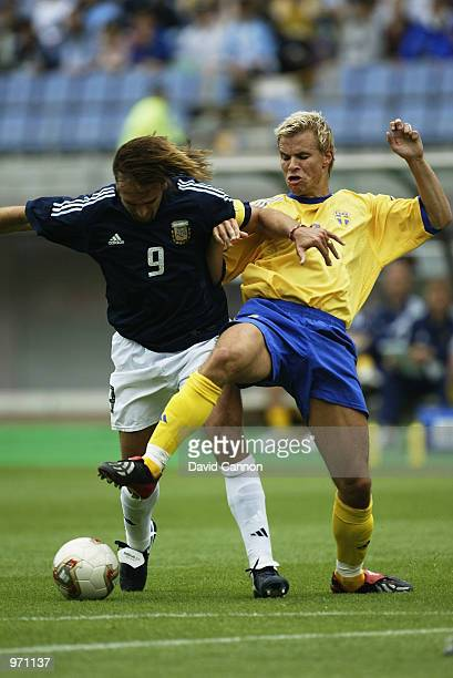 Gabriel Batistuta of Argentina holds off Niclas Alexandersson of Sweden during the Argentina v Sweden Group F World Cup Group Stage match played at...