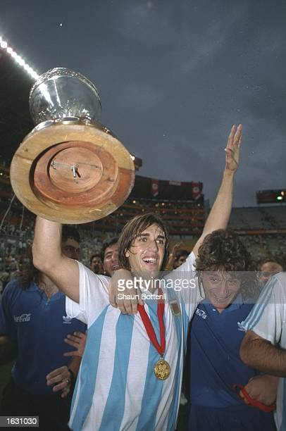 Gabriel Batistuta of Argentina holds the trophy aloft after their victory in the COPA America final against Mexico in Ecuador South America Argentina...
