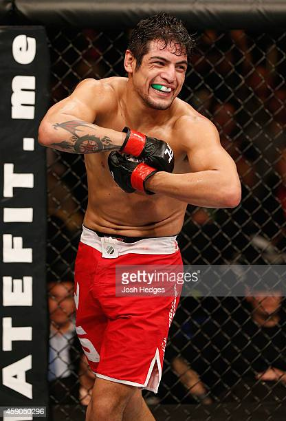 Gabriel Benitez celebrates his submission victory over Humberto Brown in their featherweight bout during the UFC 180 event at Arena Ciudad de Mexico...