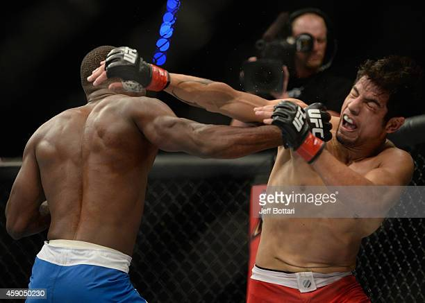 Gabriel Benitez exchanges punches with Humberto Brown in their featherweight bout during the UFC 180 event at Arena Ciudad de Mexico on November 15...