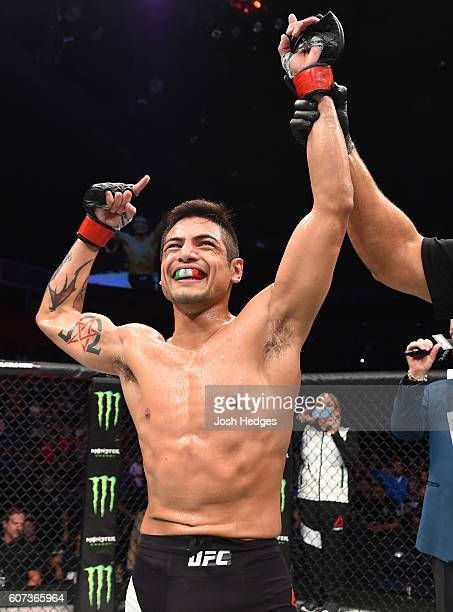 Gabriel Benitez of Mexico celebrates his submission victory over Sam Sicilia in their featherweight bout during the UFC Fight Night event at State...