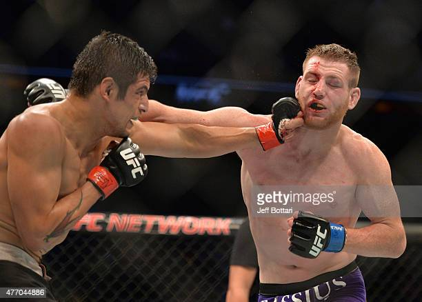 Gabriel Benitez of Mexico kicks Clay Collard of the United States in their featherweight bout during the UFC 188 event at the Arena Ciudad de Mexico...