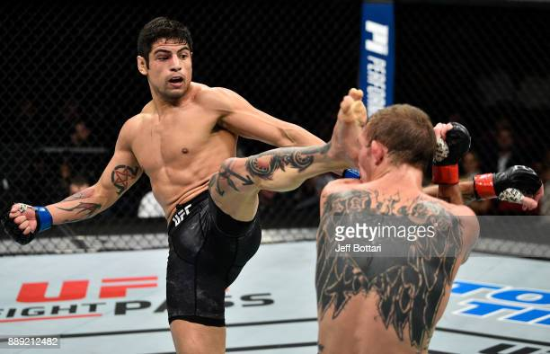 Gabriel Benitez of Mexico kicks Jason Knight in their featherweight bout during the UFC Fight Night event inside Save Mart Center on December 9 2017...