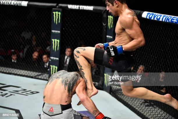 Gabriel Benitez of Mexico knees Jason Knight in their featherweight bout during the UFC Fight Night event inside Save Mart Center on December 9 2017...