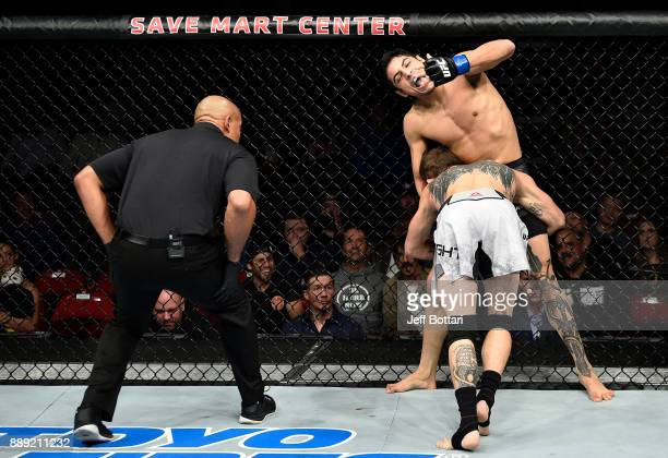 Gabriel Benitez of Mexico pclaims he is bitten by Jason Knight in their featherweight bout during the UFC Fight Night event inside Save Mart Center...