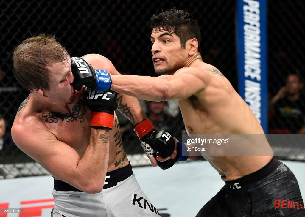 Gabriel Benitez of Mexico punches Jason Knight in their featherweight bout during the UFC Fight Night event inside Save Mart Center on December 9, 2017 in Fresno, California.