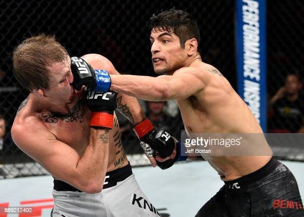 Gabriel Benitez of Mexico punches Jason Knight in their featherweight bout during the UFC Fight Night event inside Save Mart Center on December 9...