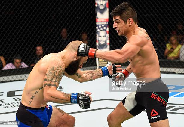 Gabriel Benitez of Mexico punches Sam Sicilia in their featherweight bout during the UFC Fight Night event at State Farm Arena on September 17 2016...