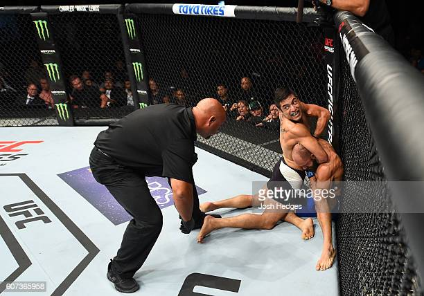 Gabriel Benitez of Mexico submits Sam Sicilia in their featherweight bout during the UFC Fight Night event at State Farm Arena on September 17 2016...