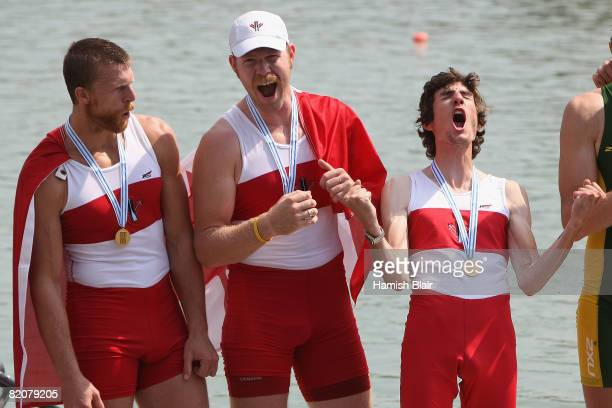 Gabriel Bergen James Dunaway Mark Laidlaw of Canada celebrate with their gold medals after the Final A of the men's coxed pair during day six of the...