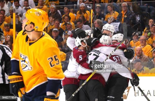 Gabriel Bourque of the Colorado Avalanche is congratulated by teammates after scoring a goal against the Nashville Predators during the first period...