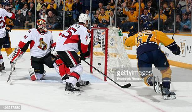 Gabriel Bourque of the Nashville Predators scores a goal against goalie Craig Anderson of the Ottawa Senators during the third period at Bridgestone...