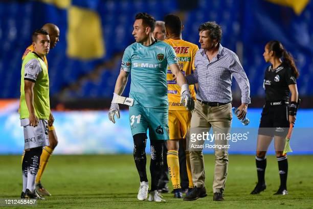 Gabriel Caballero coach of Juárez and Edmundo Vázquez of Juárez leave the pitch at the end of the 10th round match between Tigres UANL and FC Juarez...