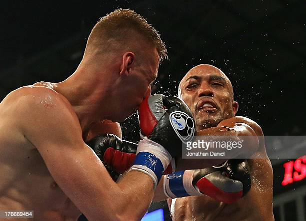 Gabriel Campillo connects with a punch to Andrzej Fonfara during an outdoor boxing event at US Cellular Field on August 16 2013 in Chicago Illinois