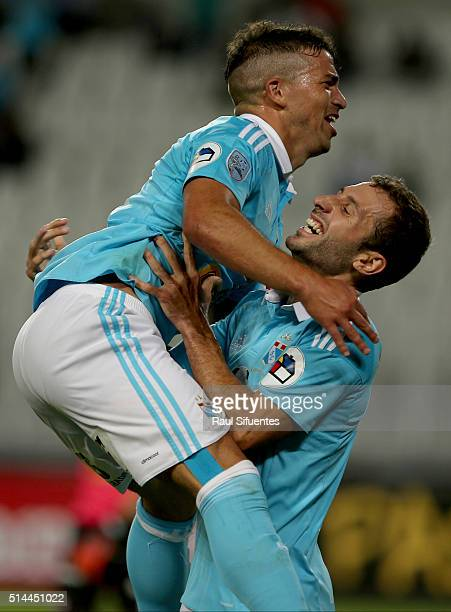 Gabriel Costa of Sporting Cristal celebrates with Horacio Calcaterra after scoring the first goal of his team against Huracan during a group stage...