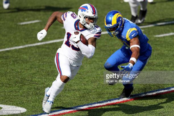 Gabriel Davis of the Buffalo Bills runs with the ball as Kenny Young of the Los Angeles Rams attempts to tackle him during the third quarter at Bills...