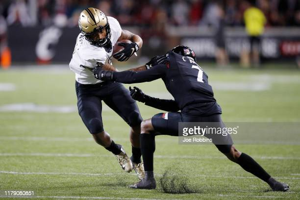 Gabriel Davis of the Central Florida Knights tries to break a tackle against Coby Bryant of the Cincinnati Bearcats in the second quarter at Nippert...