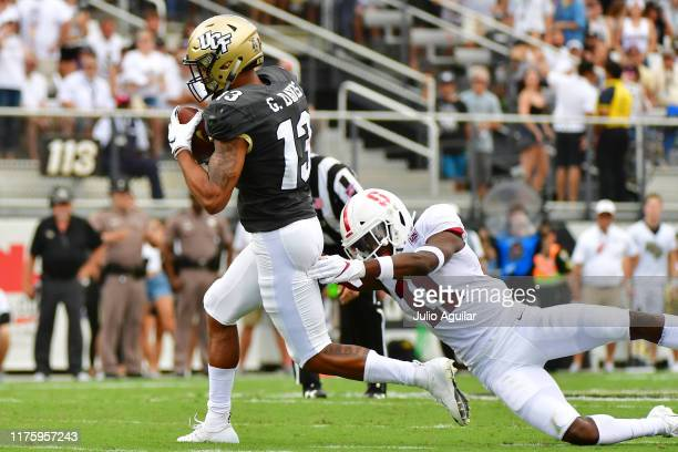 Gabriel Davis of the UCF Knights breaks a tackle by Paulson Adebo of the Stanford Cardinal during the first quarter of a football game at Spectrum...