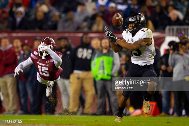 Gabriel Davis of the UCF Knights cannot make a catch on the ball against Ty Mason of the Temple Owls in the second quarter at Lincoln Financial Field...