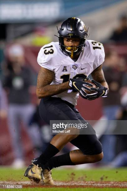 Gabriel Davis of the UCF Knights catches a pass and runs the ball against the Temple Owls in the second quarter at Lincoln Financial Field on October...