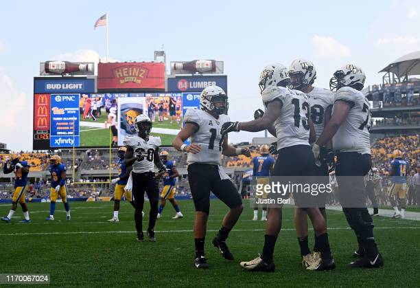 Gabriel Davis of the UCF Knights celebrates with Dillon Gabriel after 10-yard touchdown reception in the third quarter during the game against the...