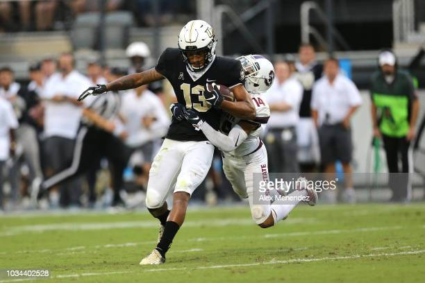Gabriel Davis of the UCF Knights gets tackled by Decobie Durant of the South Carolina State Bulldogs during a football game against the South...