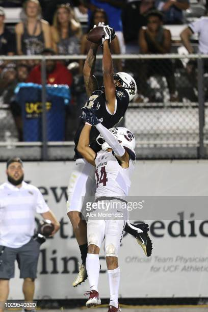 Gabriel Davis of the UCF Knights makes a touchdown reception against Decobie Durant of the South Carolina State Bulldogs during a football game at...