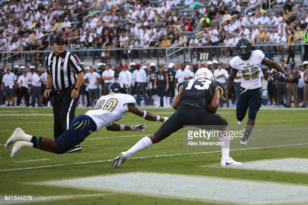 Gabriel Davis of the UCF Knights makes a touchdown reception in front of Emmanuel Lubin of the FIU Panthers and Treyvon Williams of the FIU Panthers...