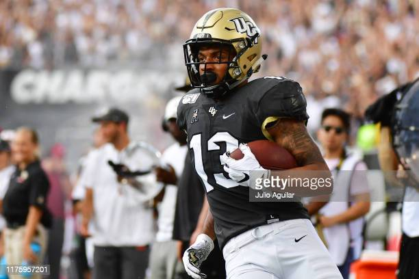 Gabriel Davis of the UCF Knights runs with the ball outofbounds during the first half of a football game Stanford Cardinal at Spectrum Stadium on...