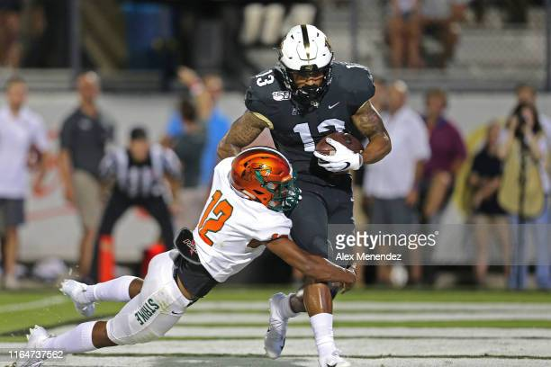 Gabriel Davis of the UCF Knights scores a touchdown in front of Kortney Cox of the Florida AM Rattlers during a NCAA football game on August 29 2019...