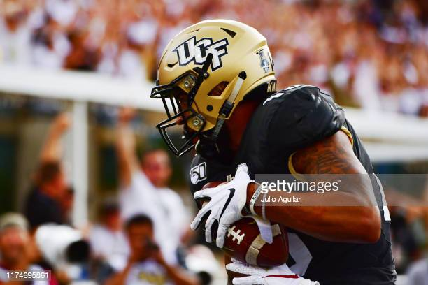 Gabriel Davis of the UCF Knights scores on 38yard pass thrown by Dillon Gabriel in the second quarter of a football game against the Stanford...