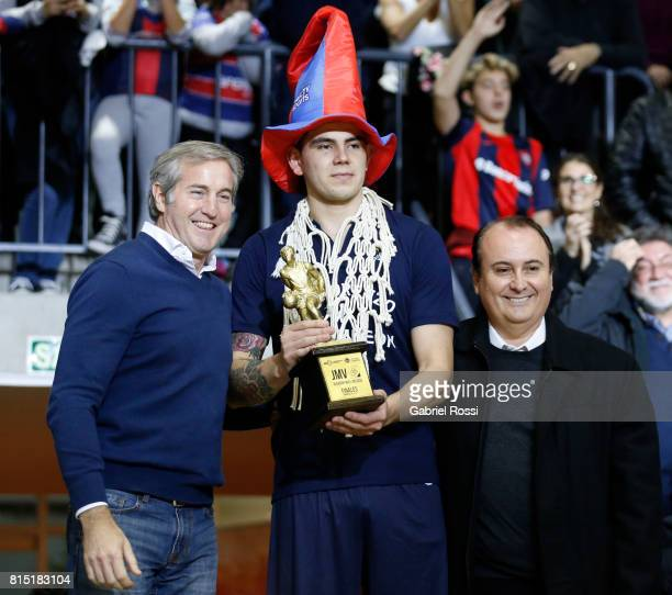 Gabriel Deck of San Lorenzo receives the MVP trophy after the fifth game between San Lorenzo and Regatas as part of LNB 2017 Finals at Roberto Pando...