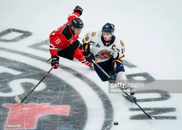 Gabriel Denis of the Shawinigan Cataractes skates with the puck against the Quebec Remparts during their QMJHL hockey game at the Videotron Center on...
