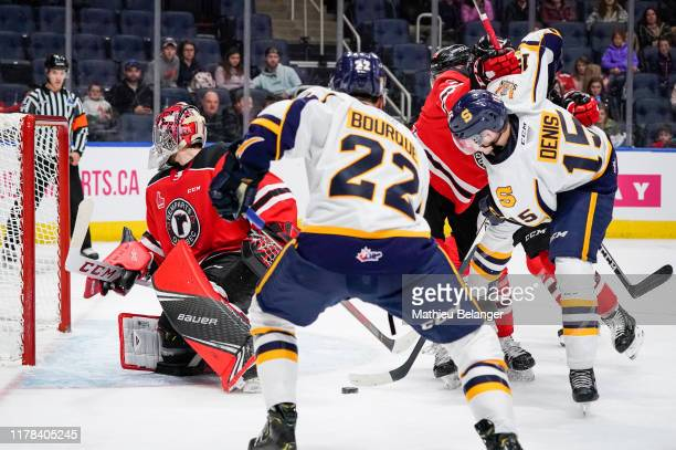 Gabriel Denis of the Shawinigan Cataractes tries to take a shot agains the Quebec Remparts during their QMJHL hockey game at the Videotron Center on...